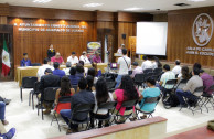 """Attendees sign an agreement between the GEAP and the Juveniles """"Mexico Stand Up and Shine"""" and """"I Believe""""."""