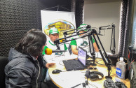 Activists of the GEAP explaining the importance of the celebration of the International Day of the Indigenous Peoples to the radio listeners and the announcers of the radio station Sopó Radio